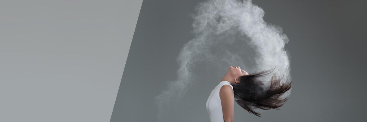 Woman using Dry Shampoo. It Works!